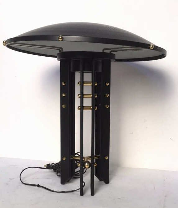Black and Gold Colored Lamp