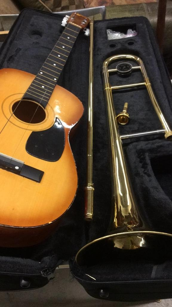 Guitar and brass trombone instruments