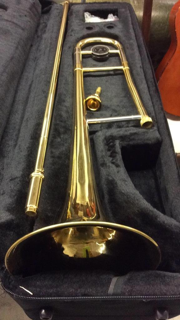 Guitar and brass trombone instruments - 5