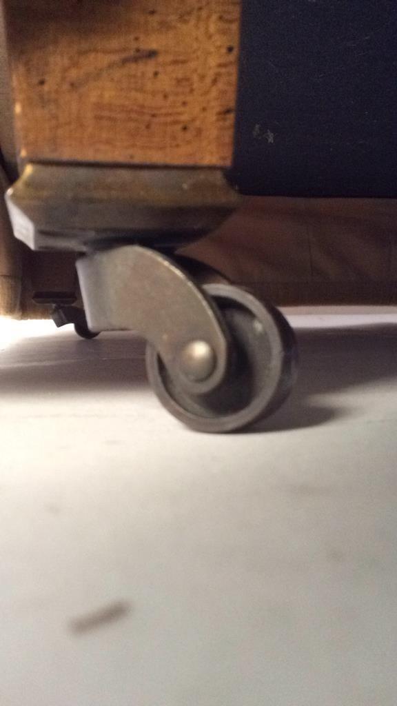 vintage ottoman on casters - 3