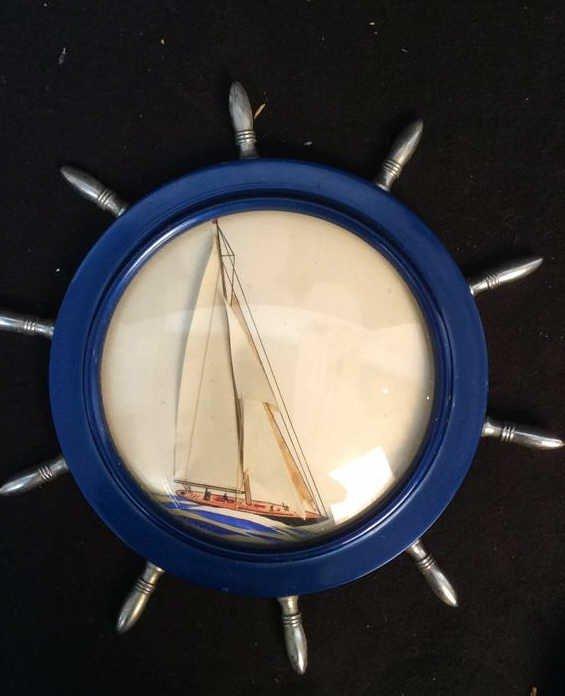 mixed media sailboat in ship wheel frame