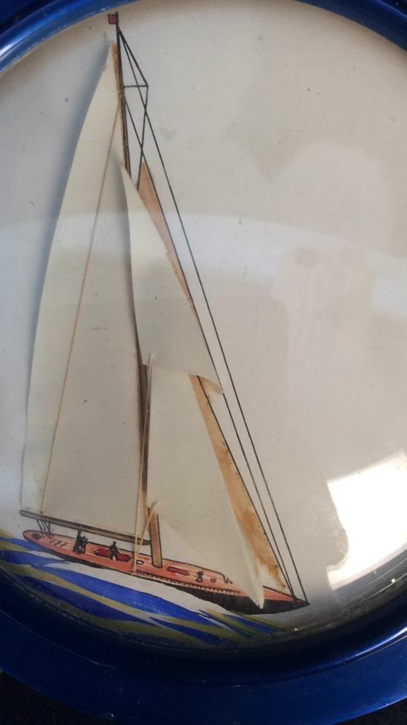 mixed media sailboat in ship wheel frame - 3