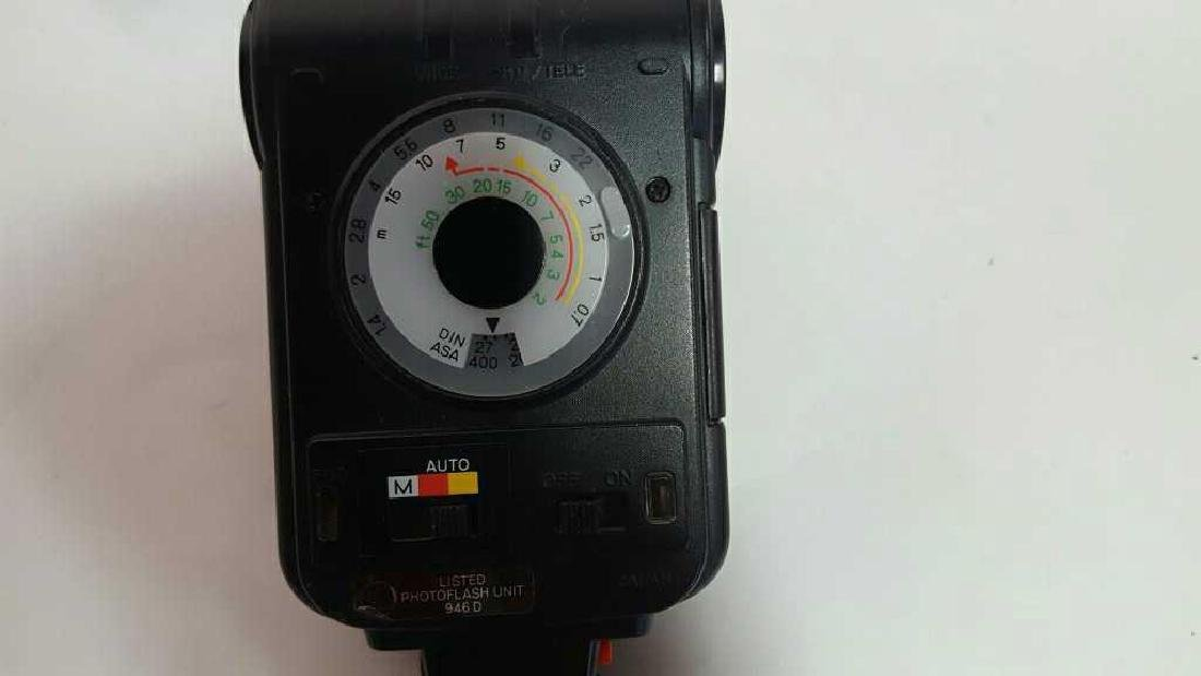 Two Minolta Flash Accessories - 8