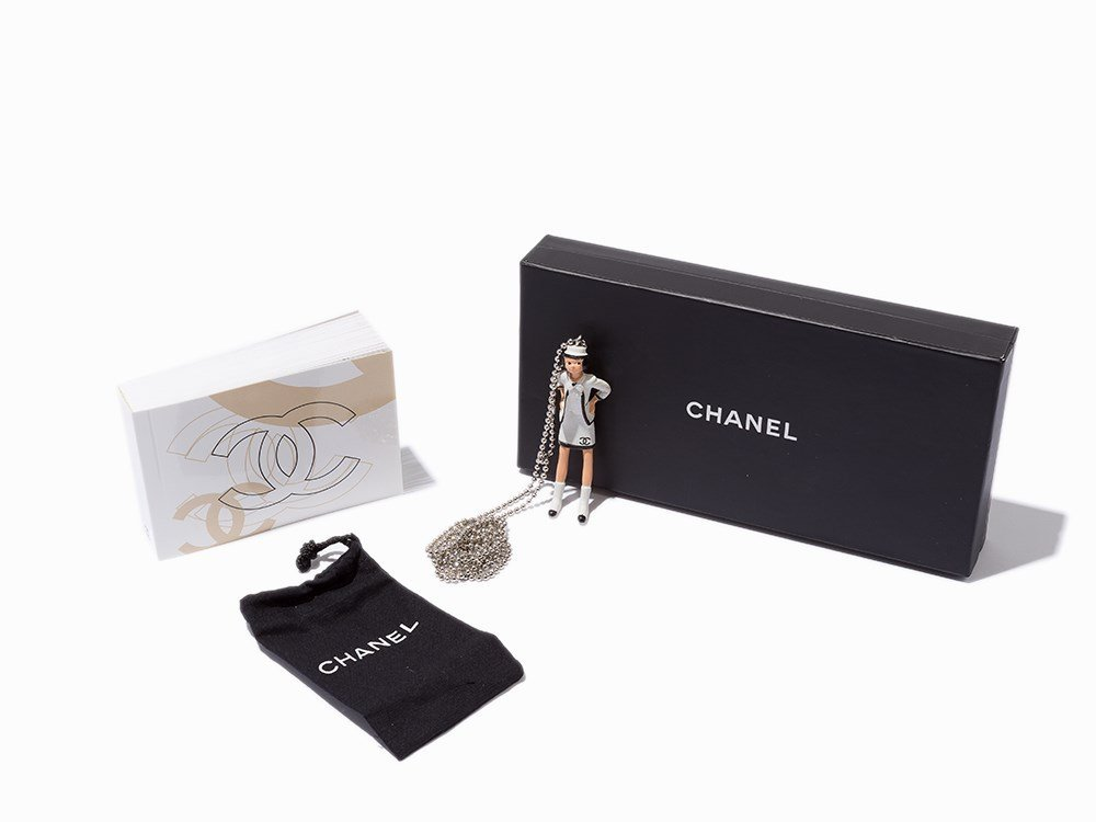 Coco Chanel Figurine Necklace with Flipbook, c. 2003