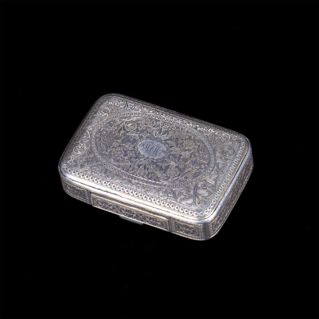 Antique Turkish silver cigarette case with a floral
