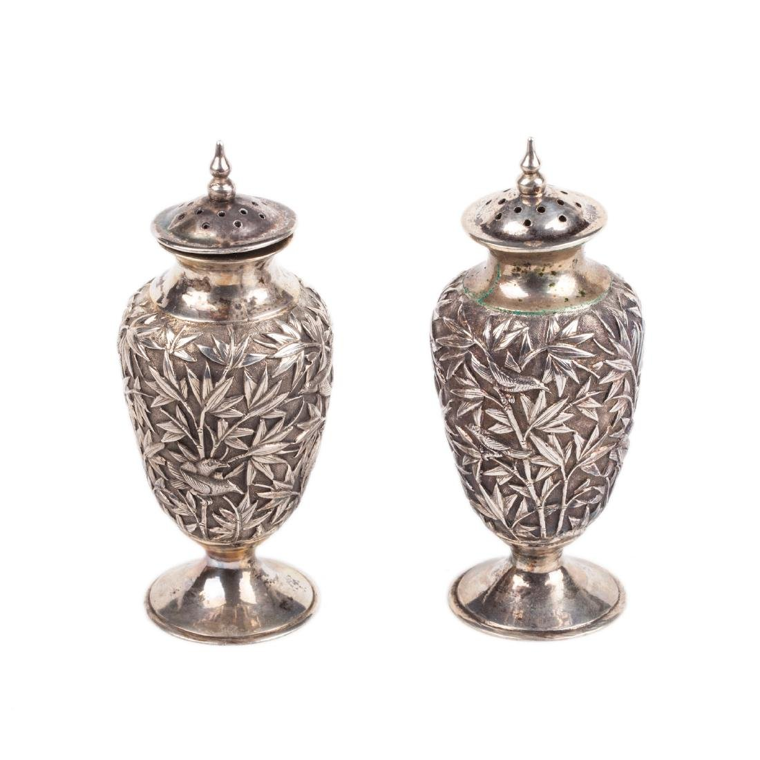 A pair of antique silver salt cellars with floral