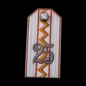 Badge in the shape of officer epaulette