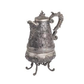 Antique silver water jug on legs
