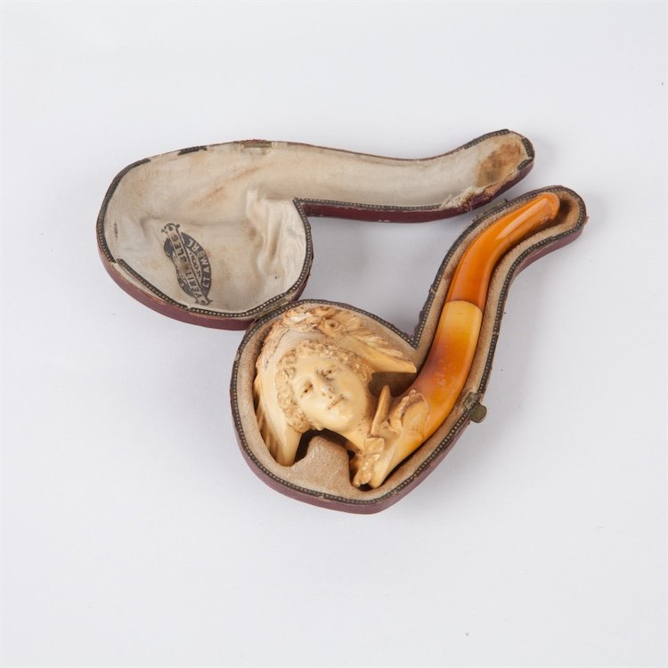Antique smoking pipe with amber in case.