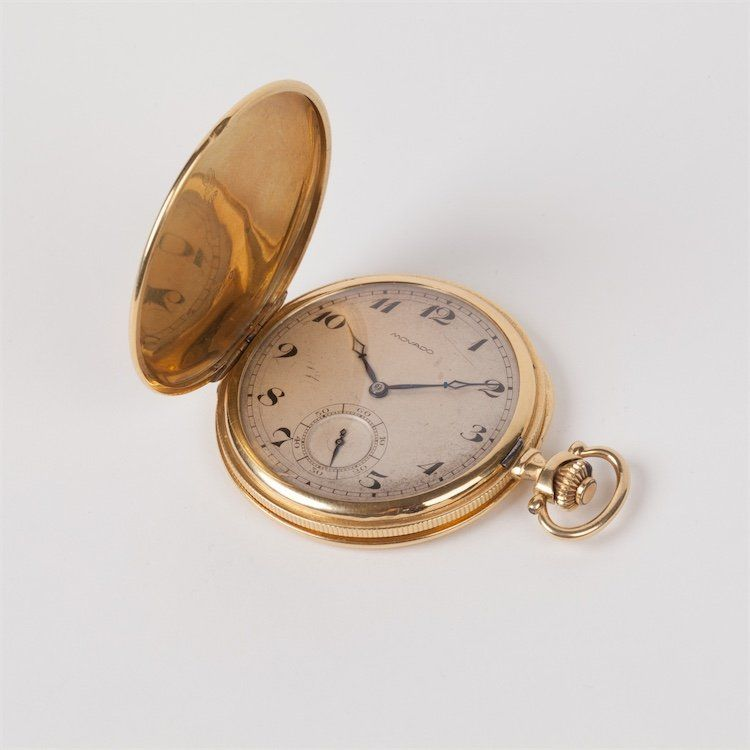 Movado gold pocket watch.