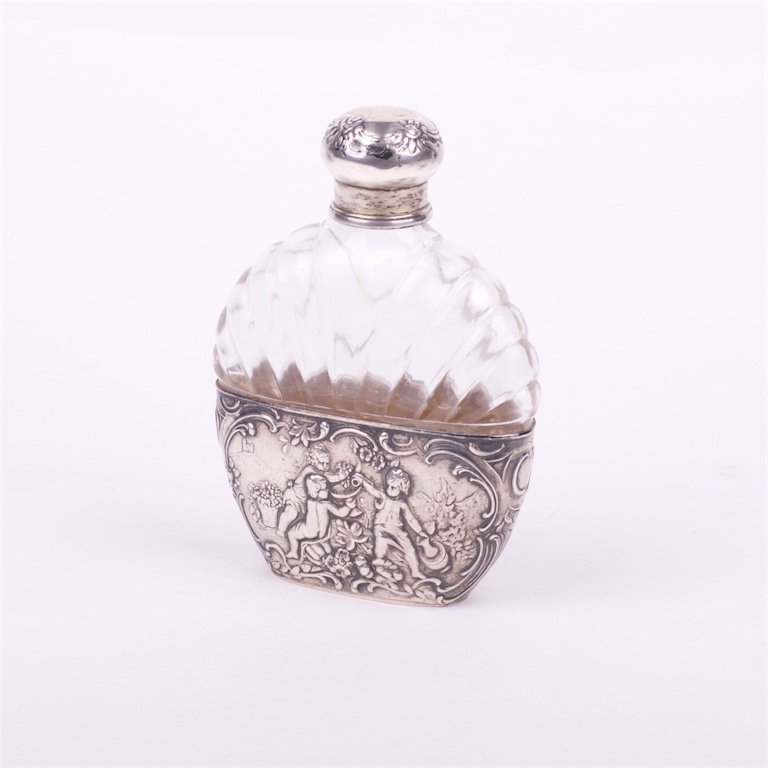 Glass bottle with silver inserts.