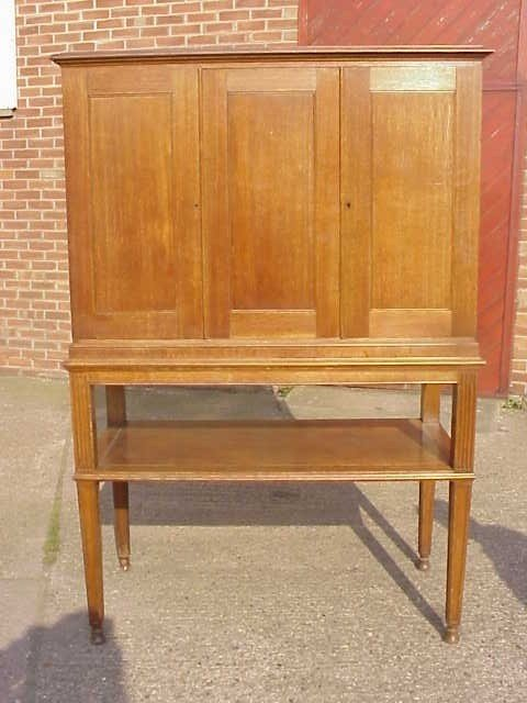 1: Arts & Crafts cabinet in the manner of Voysey