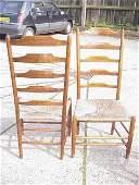 185: Oak rush seat ladder back chairs.