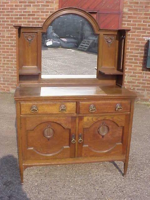 6: Arts & Crafts oak sideboard by Harris Lebus