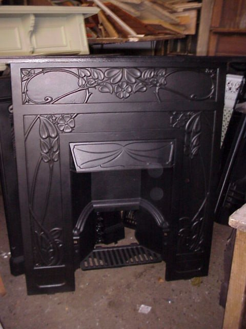 2021: Arts and Crafts cast iron fireplace