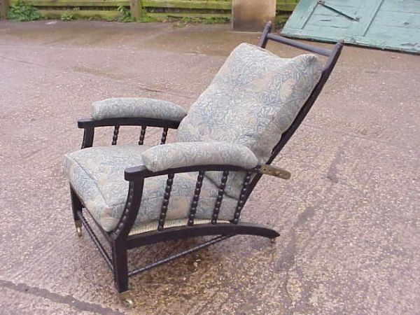 4023: Morris & Co adjustable ebonised armchair's