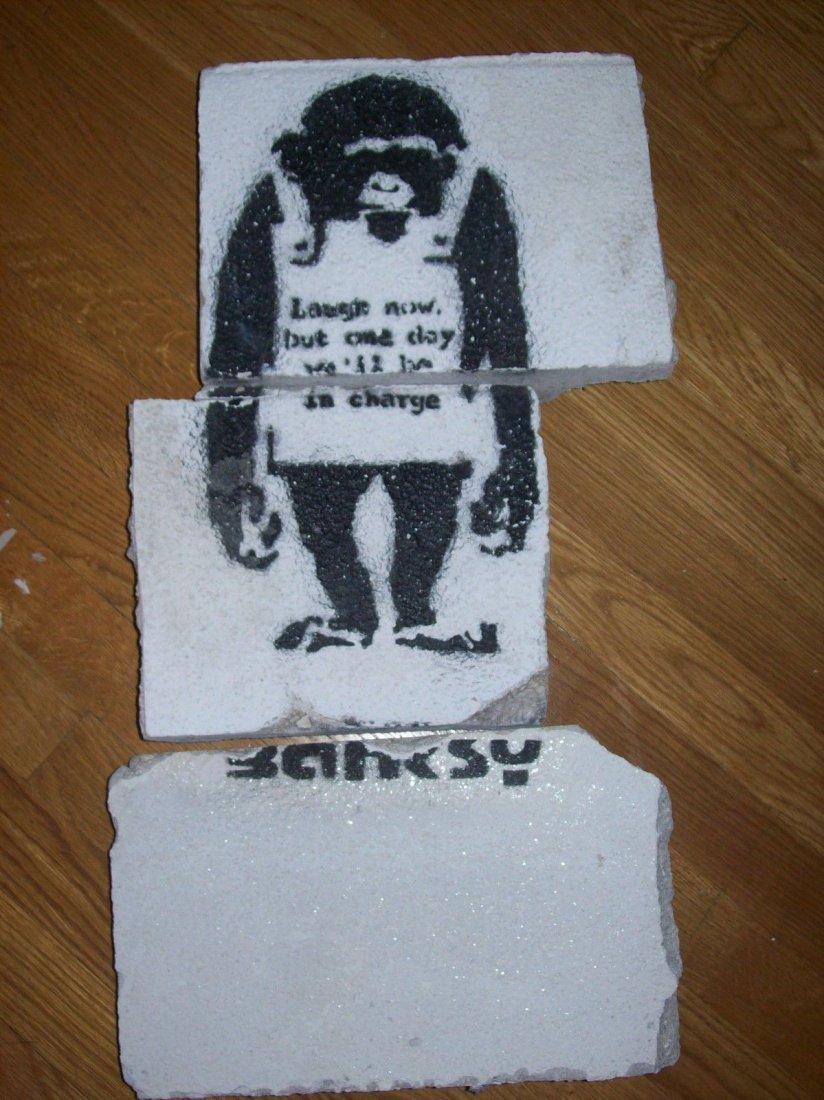 "Bansky ""Laugh Now"" rescued street art."