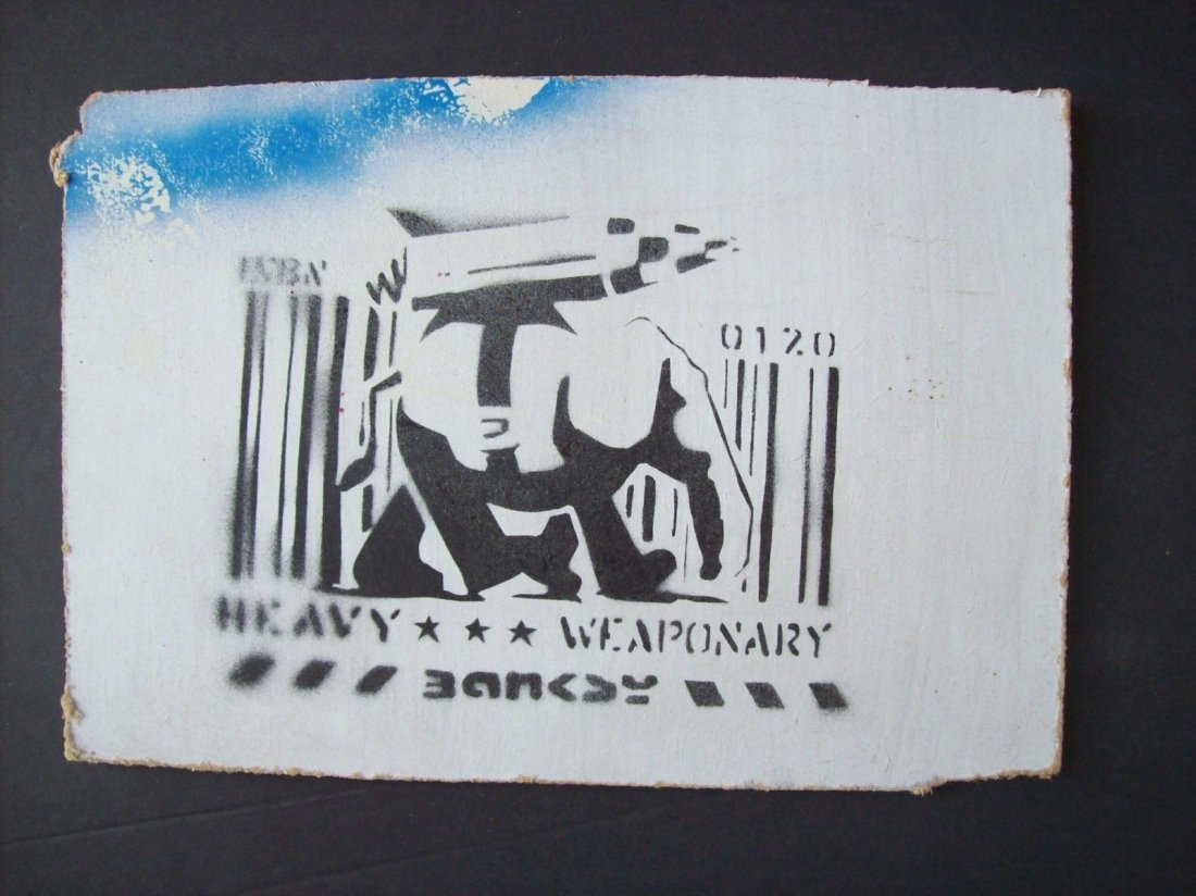 "Bansky ""Heavy Weaponry"" spray paint on board"