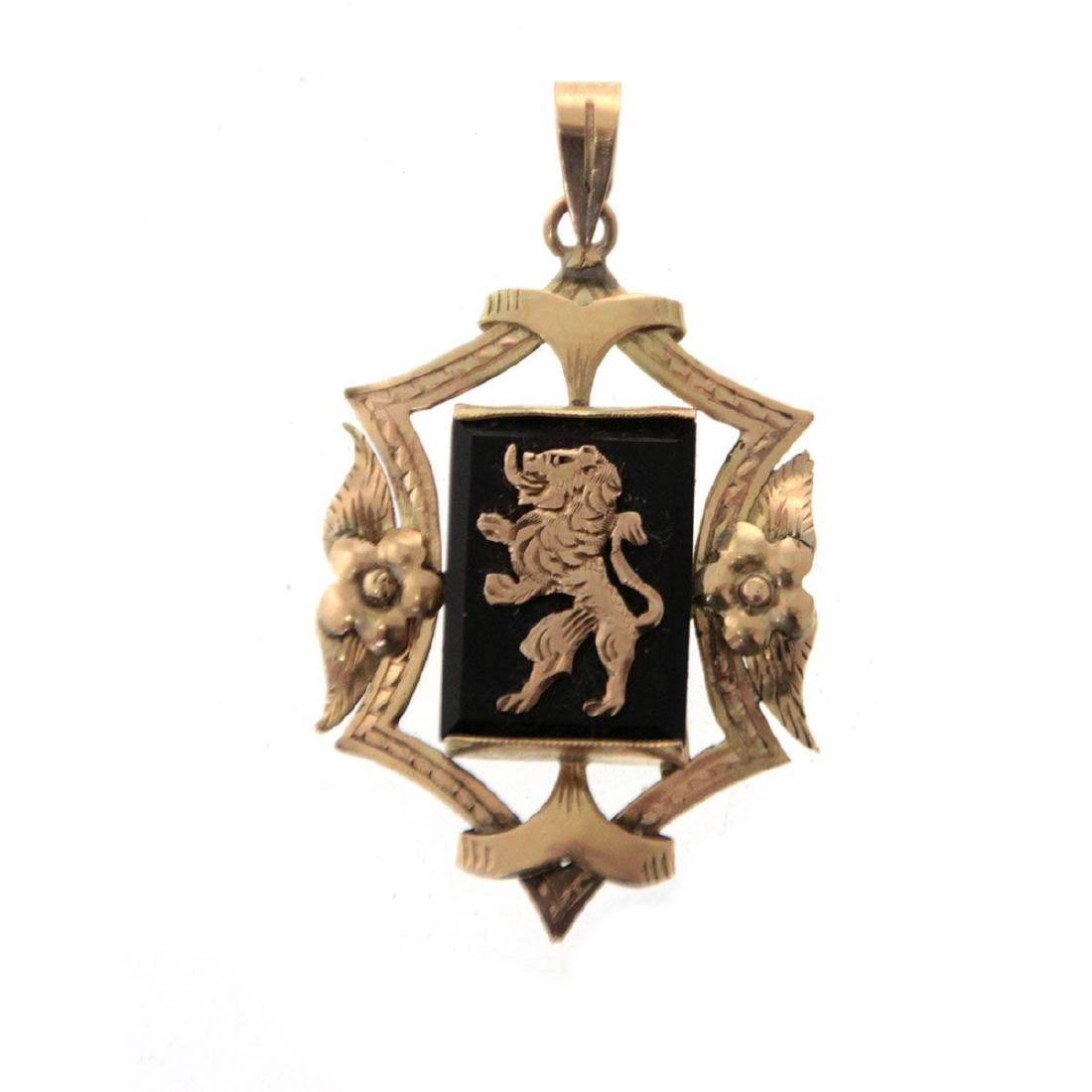 14k Yellow Gold and Onyx Pendant.
