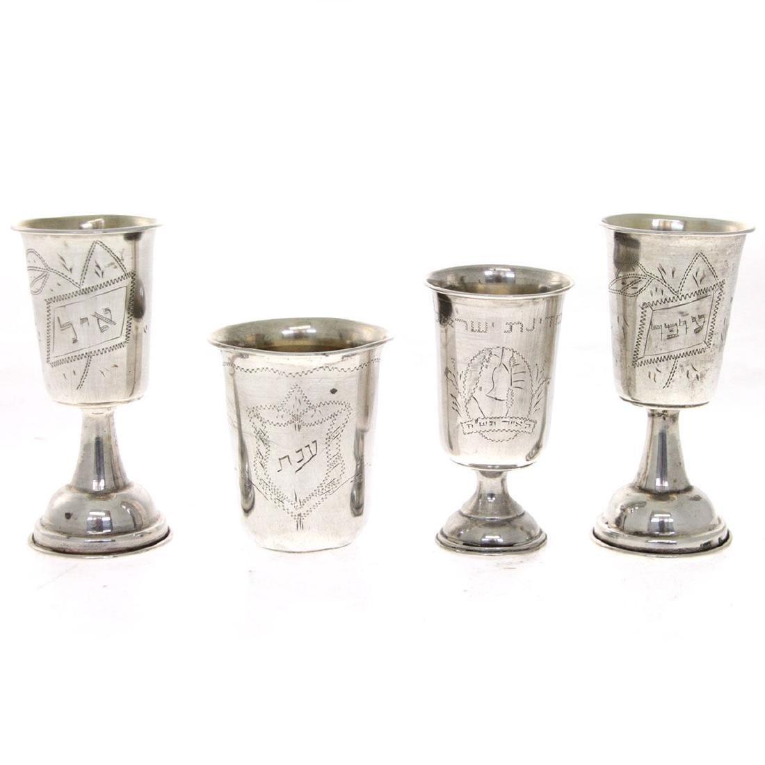Four Silver Kiddush Cups.