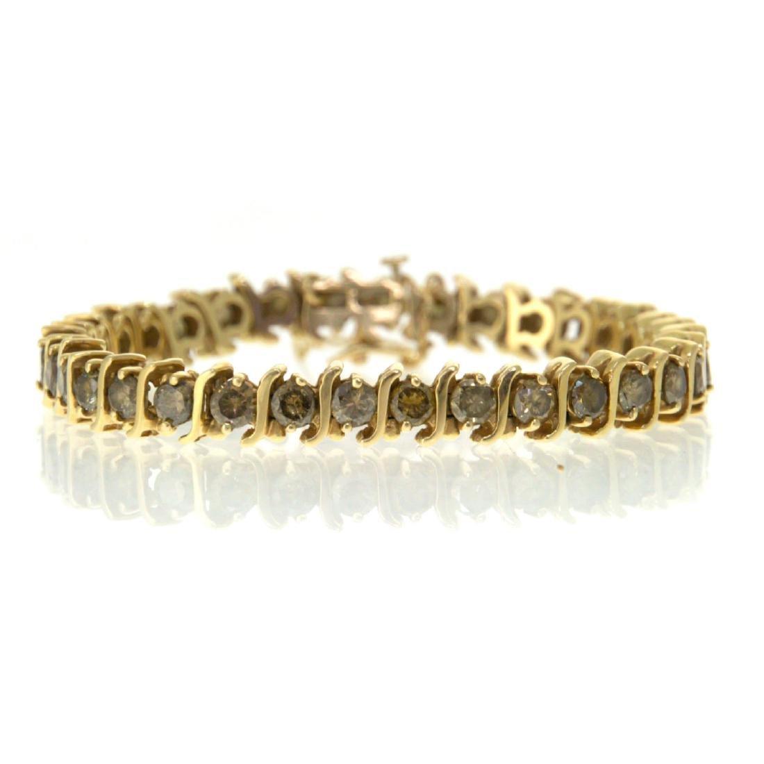 14k Yellow Gold and 9ct Diamond Tennis Bracelet.