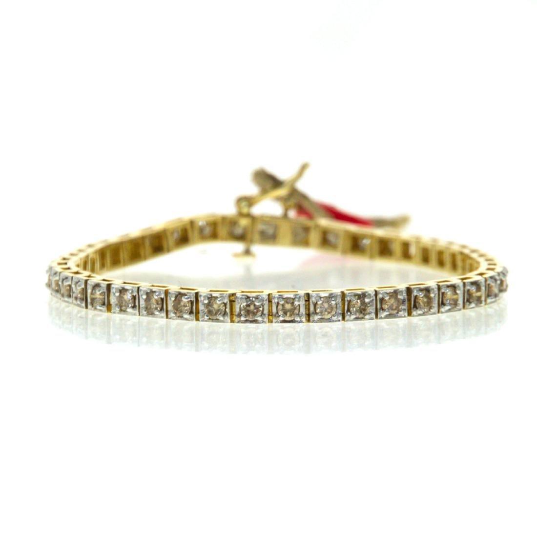 14k Yellow Gold Diamond Tennis Bracelet.