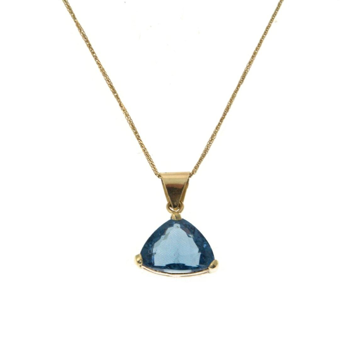 14k Yellow Gold and Blue Topaz Necklace.