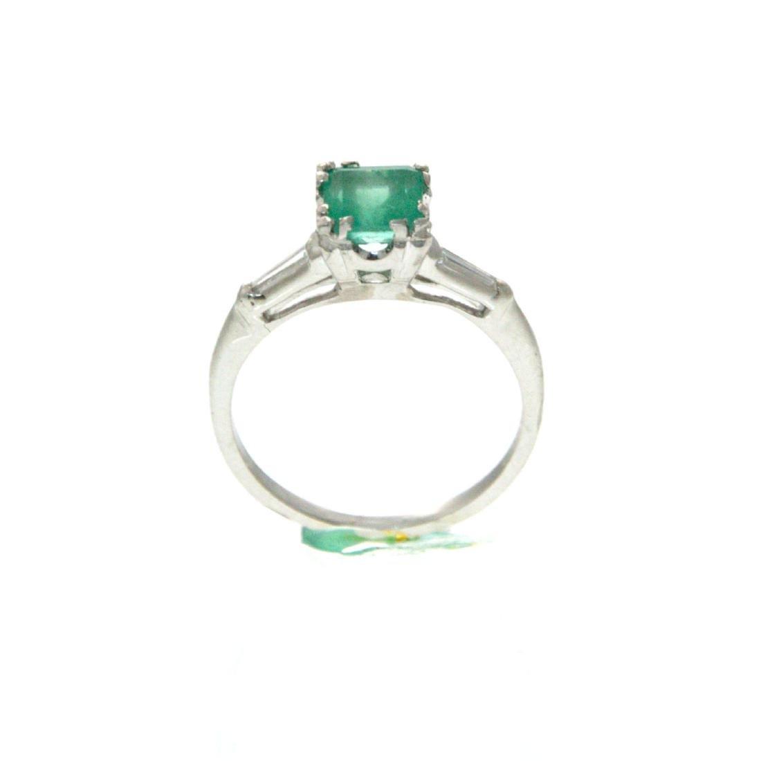 Platinum Emerald and Diamond Ring.