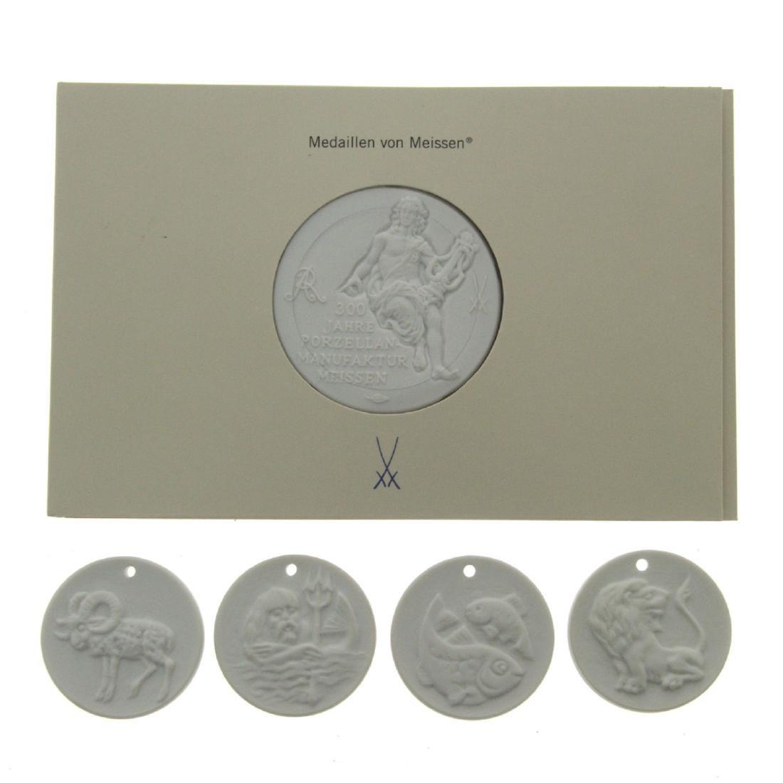 Four Meissen porcelain Zodiac pendants with company's