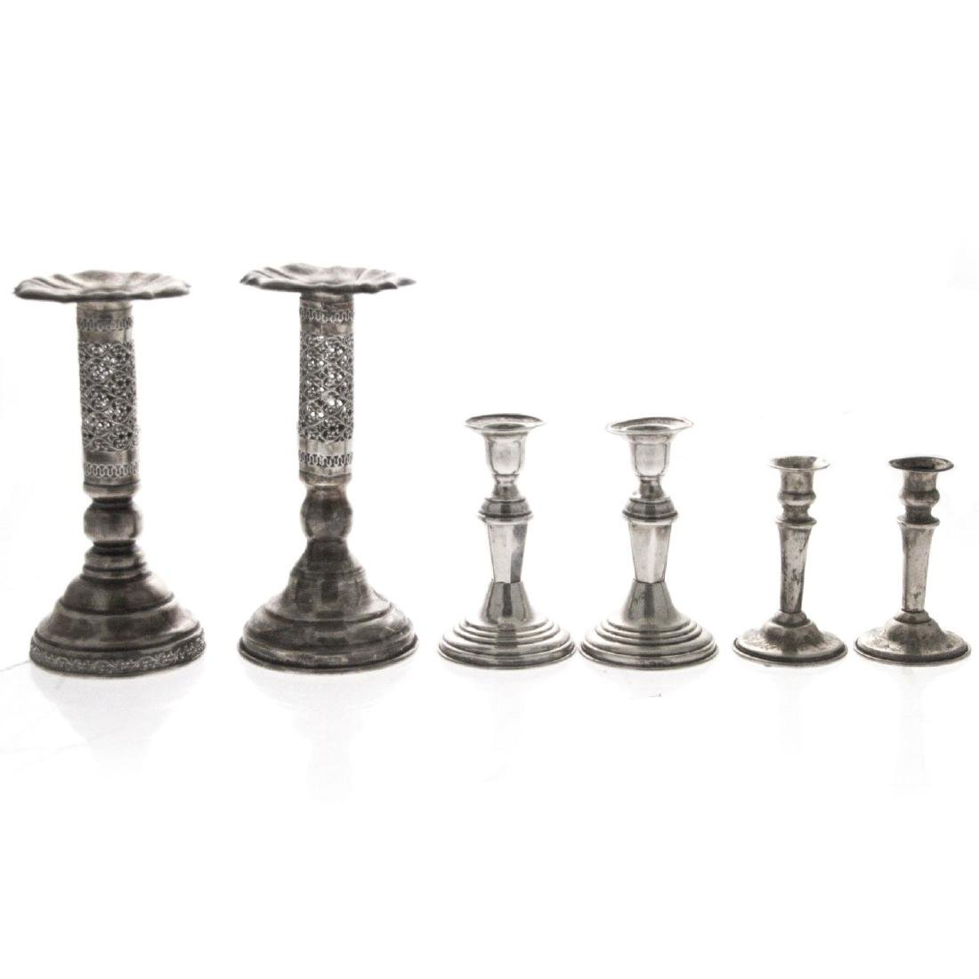 Three Pairs of Silver Candlesticks.