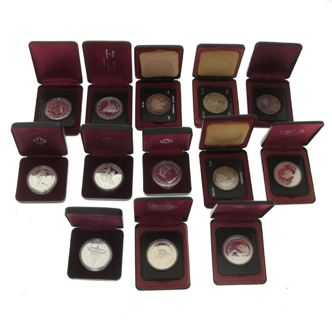 Collection of 13 Canadian Silver Dollar, 1971-1983.