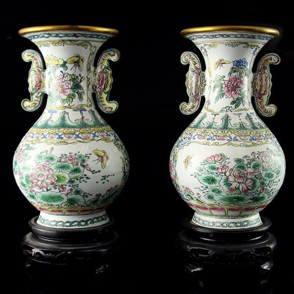 Pair of Chinese Ceramic Vases on Wooden Stands.