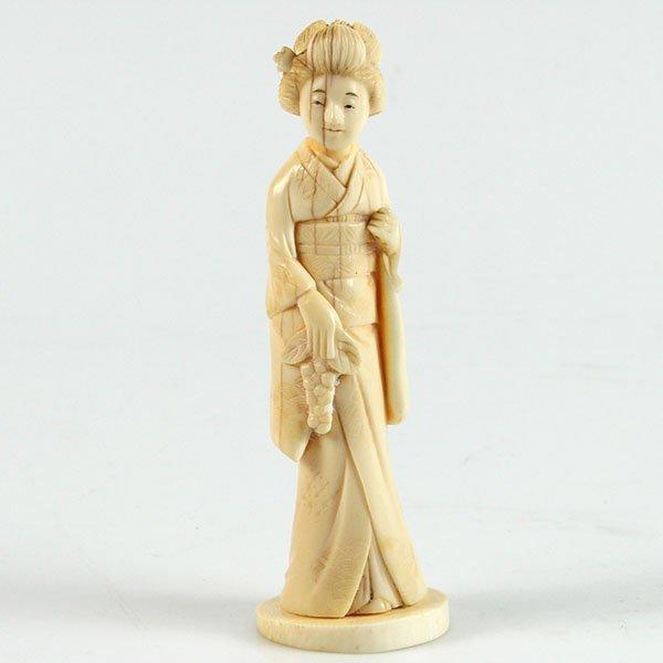 Japanese Carved Ivory Figure of a Geisha.