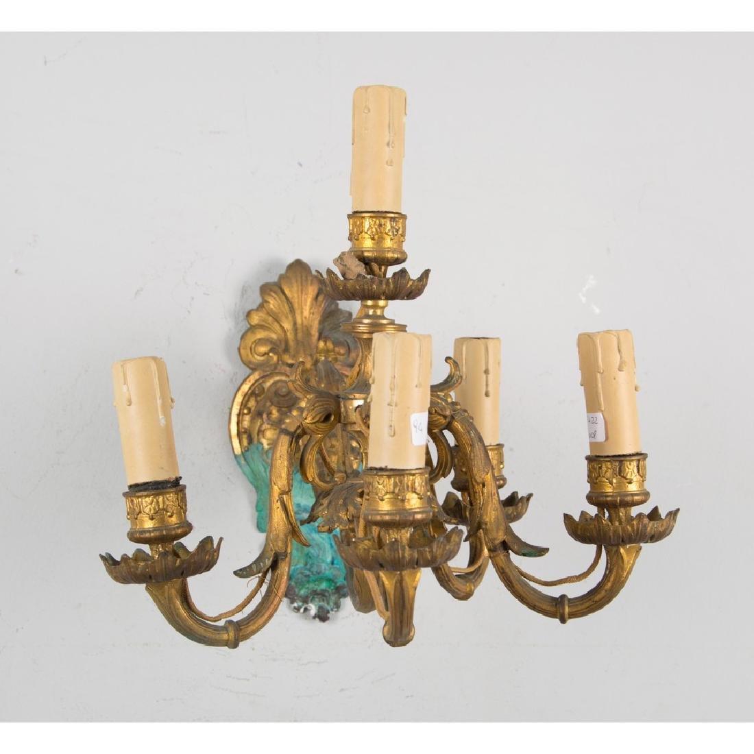 APPLIQUE a cinque luci in bronzo (elettrificato).