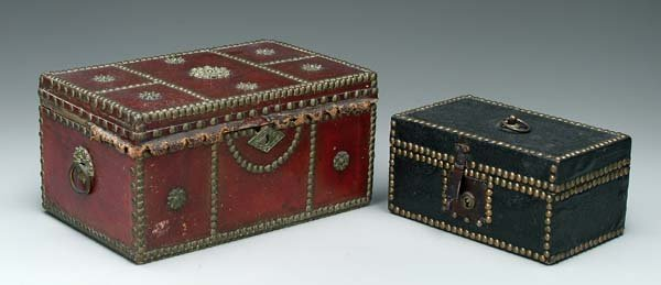 17: Two tack decorated miniature trunks