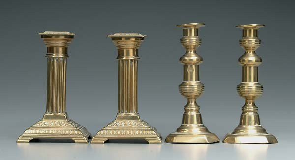 18: Two pairs brass candlesticks