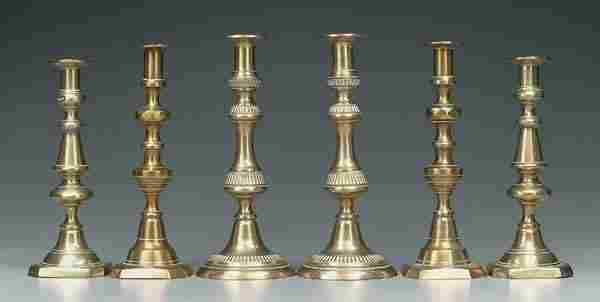 Three pairs brass candlesticks