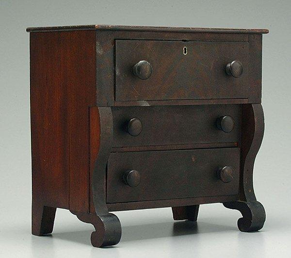 21: Miniature mahogany Empire chest,