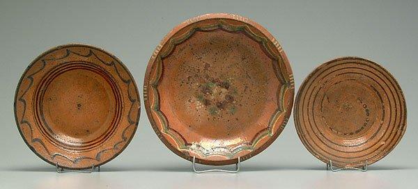 0140D: Three slip decorated redware bowls: