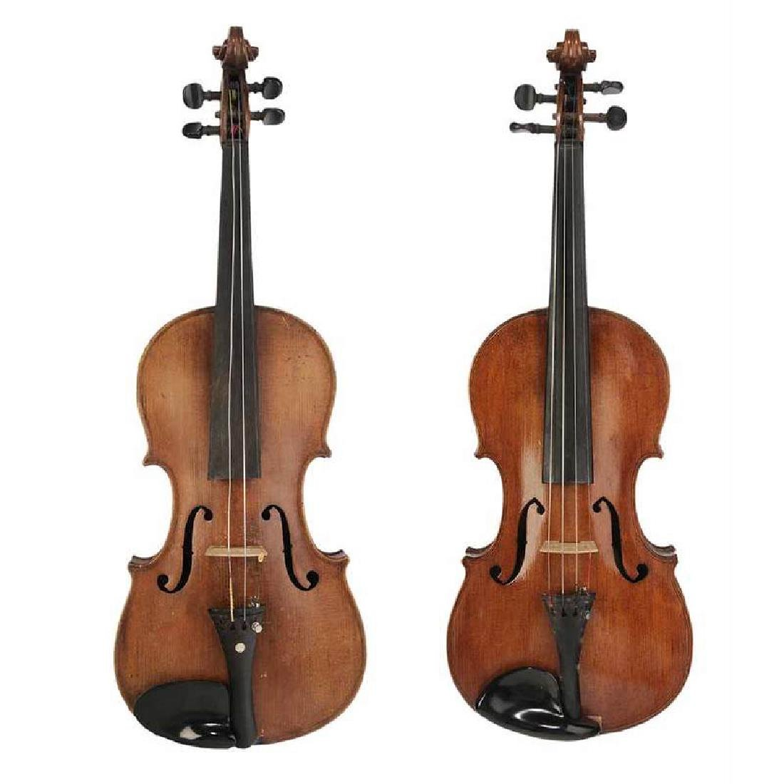 Two Violins in Cases