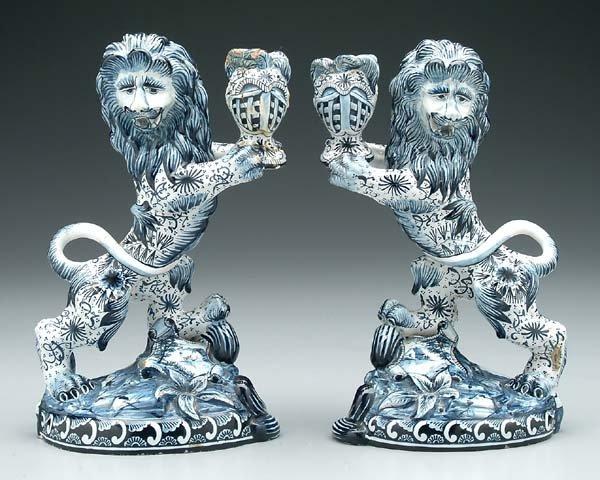 6: Pair faience lion candleholders:
