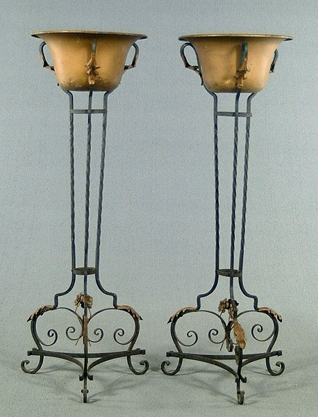 7: Pair iron and brass planters,