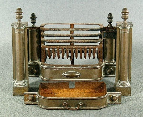 10: Iron and brass fire insert,