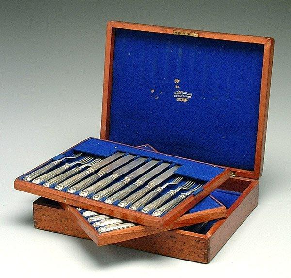 12: English silver cased fruit set,