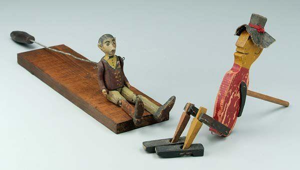 Two dancing limberjack toys