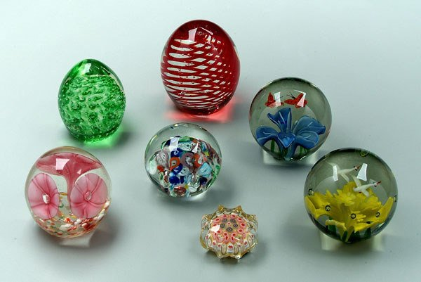 748: Seven assorted paperweights: