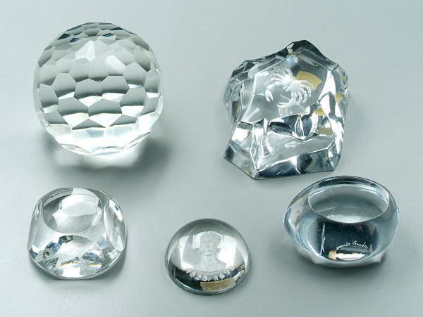 750: Five clear glass paperweights:
