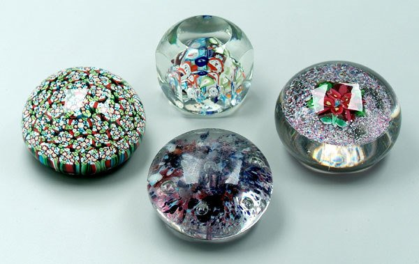 755: Four paperweights:
