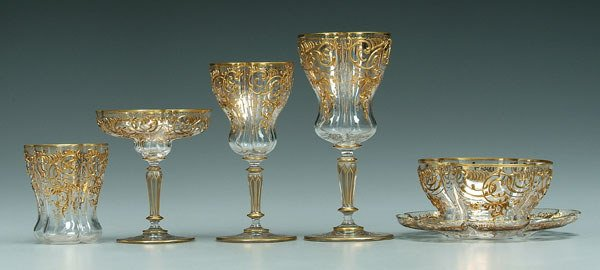 896: 68 pieces gilt decorated glassware: