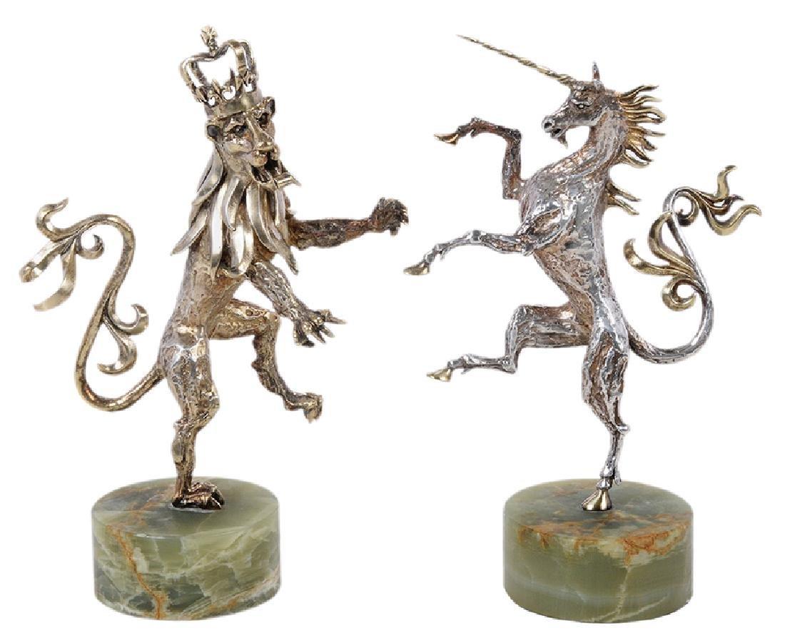 Two Gilt English Silver Figures